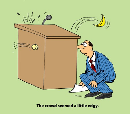 Business cartoon depicting an upset audience.