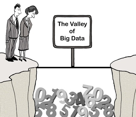 A male and a female executive look at data piled up in valley