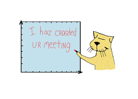 Cat writes on quarterly report Zdjęcie Seryjne