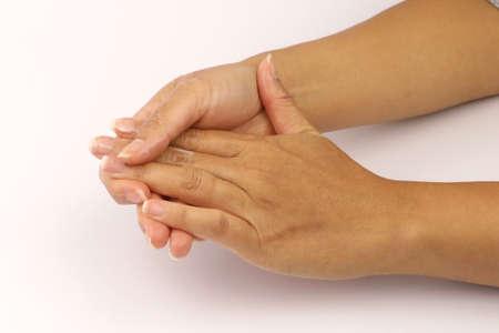 Close-up of a female moisturising her hands on a white background Reklamní fotografie