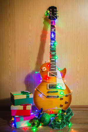 Christmas Guitar, Guitar Dress Up In A Garland With Colored Lights Close  Up, New