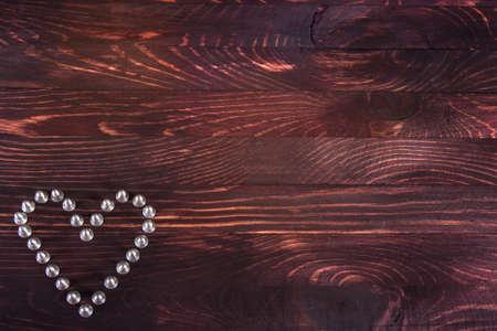 iron heart on wooden background