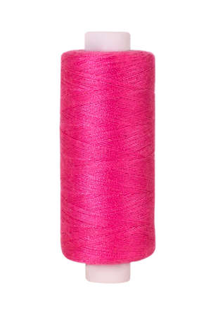 Pink sewing thread reel on white isolated background