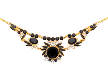 Gold jewelry with black stones on white background