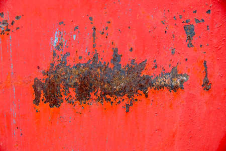 Texture of iron with rust and peeling red paint