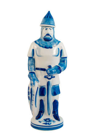 Ceramic statuette of a warrior with a sword painted under Gzhel on a white background, isolated
