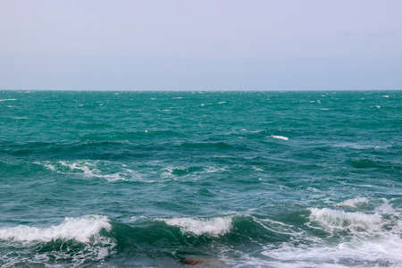 Turquoise waves in the sea. Sea view