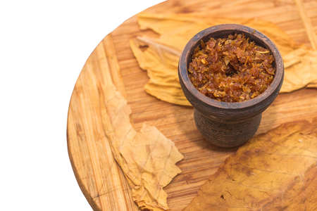Hookah tobacco is stuffed into a clay bowl for hookah
