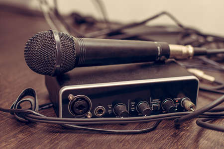 The vocal microphone is placed on the music processing device. Musical instruments