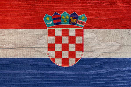 The Croatian flag with the texture of wood. Croatian flag on wooden texture