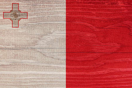 The Maltese flag with the texture of wood. Flag of Malta on a wooden texture