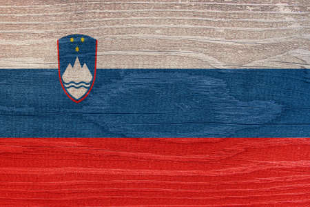 The Slovenian flag with a tree structure. Flag of Slovenia on a wooden texture