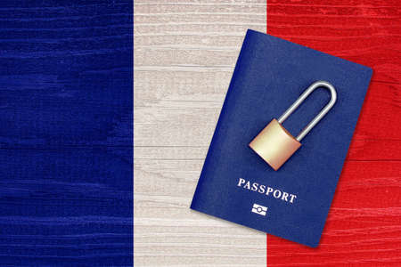 Passport and padlock on the background of the flag of France. Ban on leaving the country. Travel abroad is closed. French flag and passport. Ban on entering the country