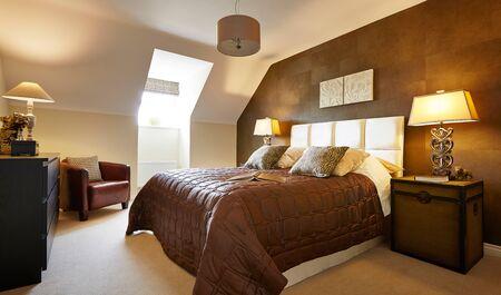 Home interior of a contemporary bedroom with furniture Archivio Fotografico
