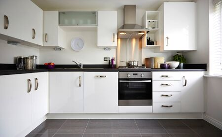 Modern interior of a large kitchen with modular furniture in white color