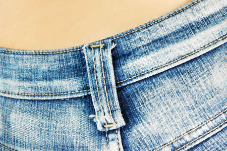 butt tight jeans: closeup of a females bottom in tight blue jeans