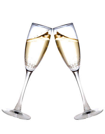 two champagne glasses raised in a toast