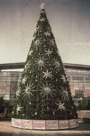 shopping centre: Artificial Christmas fir tree near the shopping centre on one of the streets of Moscow, Russia Stock Photo