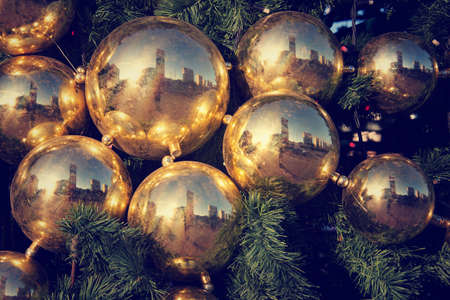 yellowish green: Gold colored Christmas decorations on green fir tree in Moscow, Russia