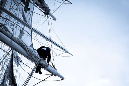 Crew up the mast of a tall ship.