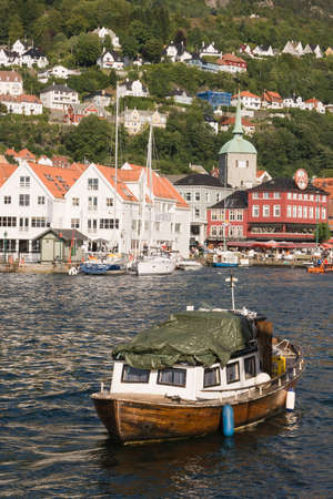A Boat in Bergen Norway with the famous Bryggen in the background.