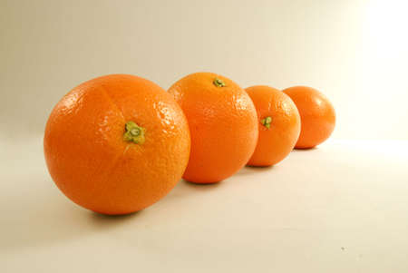 conformance: Four oranges on silver background