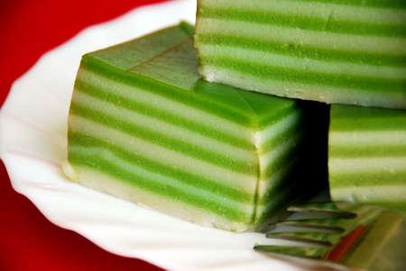 Asian delights, nyonya kueh lapis, pandan (green layer cake) photo