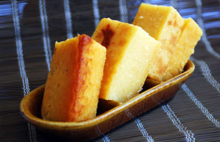 starchy food: Asian delights, nyonya kueh - Bingka telur (Cassava Cake - egg) Stock Photo