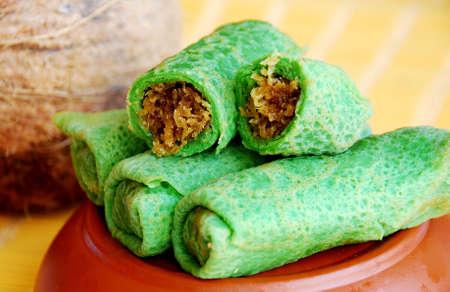 Asian delights, nyonya kueh - Ketayap, Kueh Gulung (Pandan coconut rolls) Stock Photo