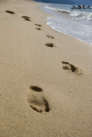 pictorial  representation: Footprints on the beach Stock Photo
