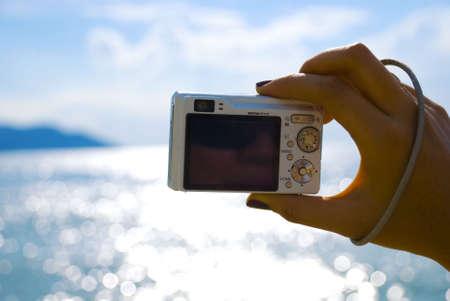 Hand photographing beach - summer Stock Photo