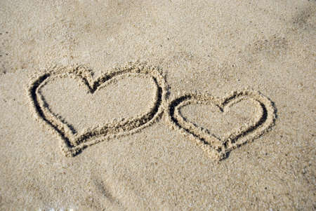 shaped: Two Heart shape on beach - love concept Stock Photo