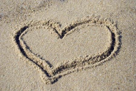 wooing: Heart shape on beach - love concept