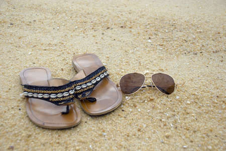 suave: Female sandal and shades on the beach
