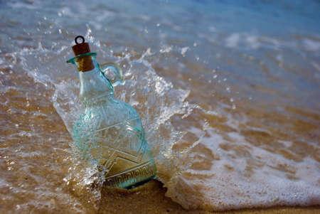 Splash, wave hit message in the bottle Stock Photo