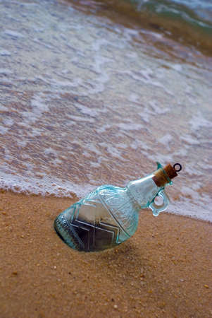 Beautiful bottle lying on beach photo