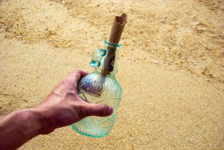Picking up message in the bottle Stock Photo - 3158975