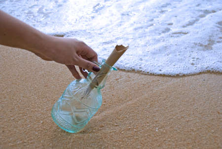 Picking up message in the bottle Stock Photo - 3159029