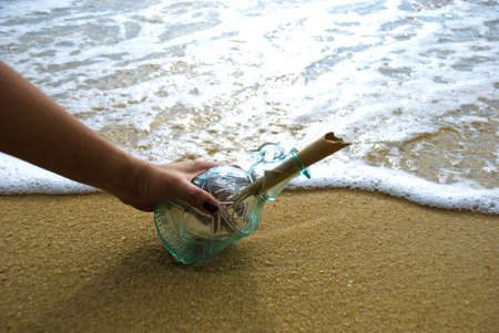 Picking up message in the bottle Stock Photo - 3158990