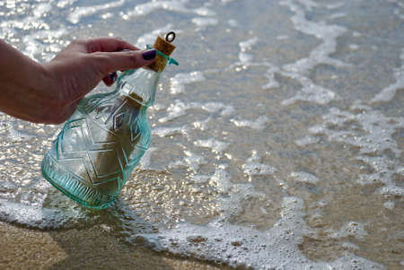 Picking up message in the bottle Stock Photo - 3159031