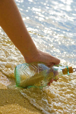 Picking up message in the bottle Stock Photo - 3158979