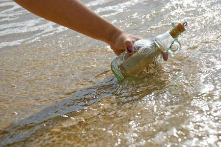 Picking up message in the bottle Stock Photo - 3158984
