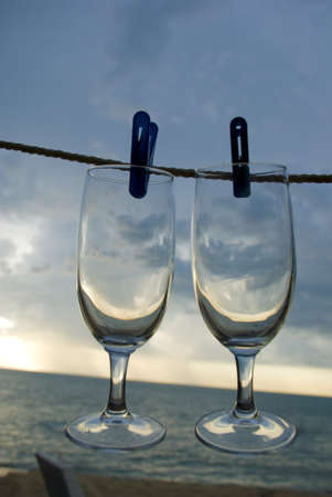 Wine goblets at beact - concept shot photo