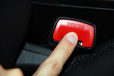 kockázatos: Press, unbuckle - risky business concept shot