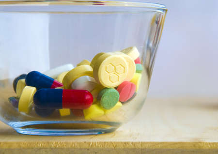 tight filled: Glass half filled with medication pills