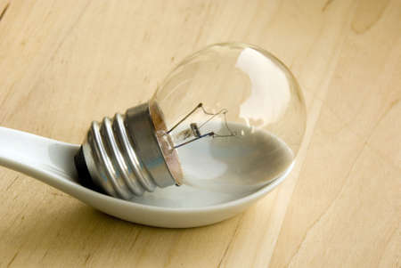 Light bulb - all ideas in a spoon Stock Photo - 3318514