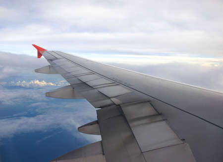 Plane wing - blue sky, clouds Stock Photo - 3411681