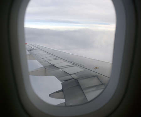 airborne vehicle: Boeing Plane wings - blue sea view, window Stock Photo