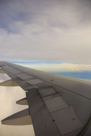 airborne vehicle: Boeing Plane wings - grey cloud view