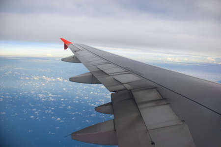 Boeing Plane wings - blue sea view photo